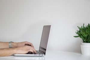 business man writing website content at desk perth